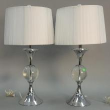 Pair of chrome and glass table lamps, total ht. 30in.