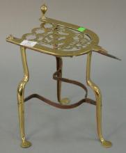 Federal brass trivet on penny foot. ht. 13 1/2in.