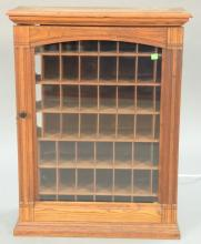 Victorian one door cabinet with pigeon holes. ht. 30in., wd. 23in.