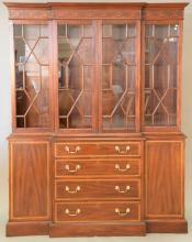 Henkel Harris mahogany breakfront in two parts with glass shelves (two small shelves with small crack and one small shelf missing). ...