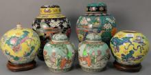Six piece lot to include three pairs of Oriental Porcelain jars with carved hardwood stands (one cover missing). ht. 8in. to 12in.