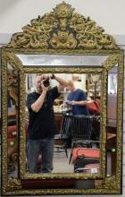 Baroque style embossed brass mirror, ht. 52in., wd. 33 1/2in.