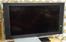 Sony Bravia 40 inch TV along with Yamaha subwoofer YST-S W100 and Polk speaker.