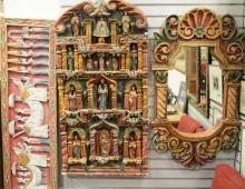 Three piece lot including carved and painted Spanish style mirror and two wall hangings, 23