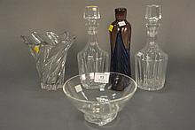 Five piece lot including two vases ht. 10in. & 7in., Steuben dish ht. 4in., and two decanters with stoppers marked Hawks ht. 10 1/2in.