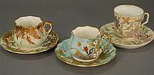 Seven cups and saucers, two patterns with birds, flowers, and high relief gold marked Burslem and four other painted cups and saucers.