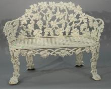 Iron Victorian bench having grape and vine motif and openwork seat. height 31 inches, width 44 inches Provenance: Property from t...