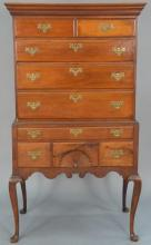 Queen Anne mahogany highboy in two parts, upper portion with flat top having cornice molding over two short drawers over three long...