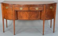 Federal mahogany sideboard having shaped bowed front with two center drawers over two doors and flanked by two doors. height 39 inc...