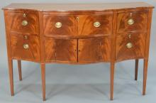 Federal mahogany sideboard with D shaped top over conforming case having drop front top center drawer over two doors flanked by doub...