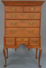 Queen Anne cherry highboy in two parts, upper portion having document drawer in cornice molding over two short drawers over three dr...