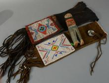 Three piece lot to include Hopi Kachina polychrome carved wood doll and two beaded bags. height 9 3/4 inches