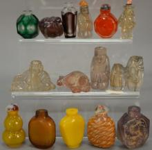 Fifteen glass, crystal, and quartz snuff bottles, some possibly Peking glass.  ht. 1 1/4in. to 2 3/4in.