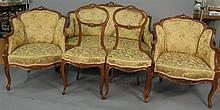 Five piece Louis XV salon suite including loveseat, two armchairs, and two side chairs.