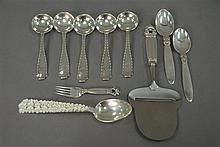 Five Tiffany soup spoons, pair of Georg Jensen spoons, small fork, cheese slicer, and Michelsen spoon, 7.8 t oz.