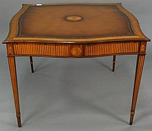 Maitland Smith game table with inlaid and leather top and four drawers, signed Maitland Smith, ht. 30 in.; top: 41