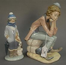 Two Llardros including sad clown with accordion ht. 9 in. and a boy with dog ht. 8 in.