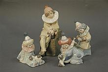 Group of four Lladros including a girl with a book and three small clowns, ht. 4