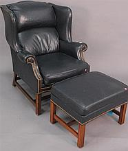 Signed Schaffer Brothers Chippendale style navy blue leather wing chair and ottoman.