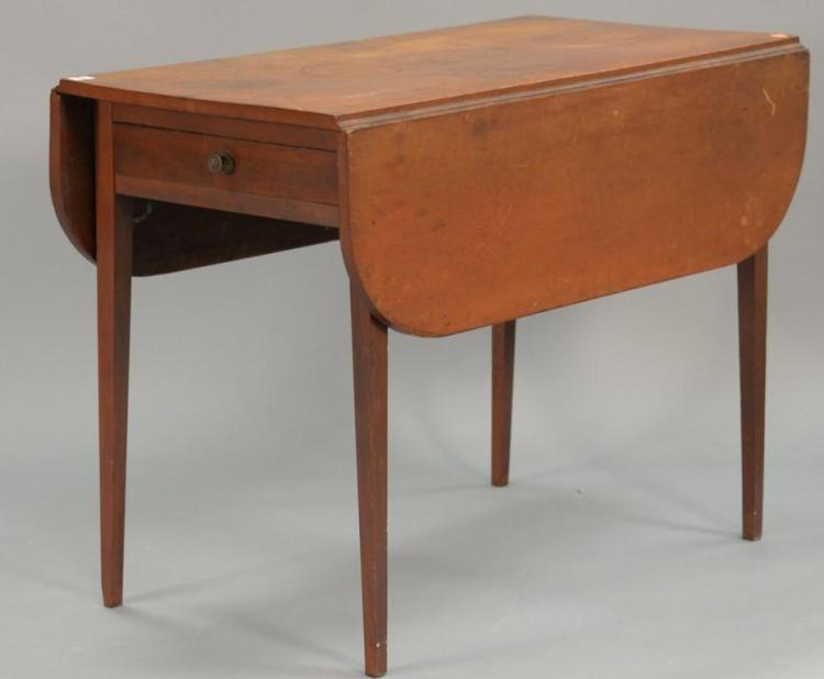 Federal cherry drop leaf table with four drawers, circa 1800. ht. 27