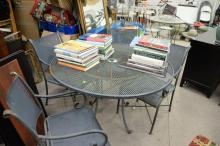 Five piece lot including mesh metal table and four armchairs. dia. 48in.