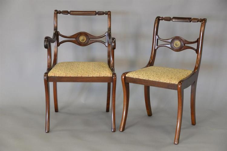 Duncan Phyfe mahogany table with three leaves and six chairs each with brass plaque. ht. 29 1/2in.; top: 66
