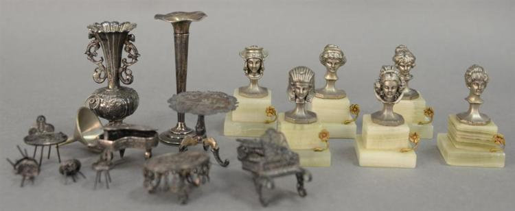 Group of silver miniature pieces including two sterling pianos, filigree silver table four chairs and a bench, sterling tall table, ...