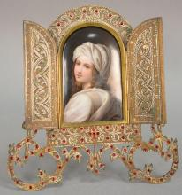 Painting on German porcelain plaque in a brass frame, mounted with red stones or glass.7 1/2