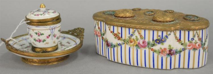 Two French porcelain ink wells including an oblong porcelain inkwell with brass fitted top late 18th to early 19th century and a por...