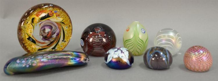 Eight art glass paper weights, three signed indistinctly.