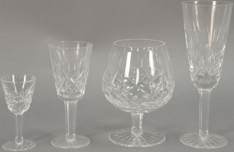Eighteen Waterford crystal pieces including set of six stemmed cordials, set of four stemmed brandy glasses, set of four large water...