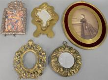 Five bronze and brass frames to include a large oval French frame and silverplated frame. 8