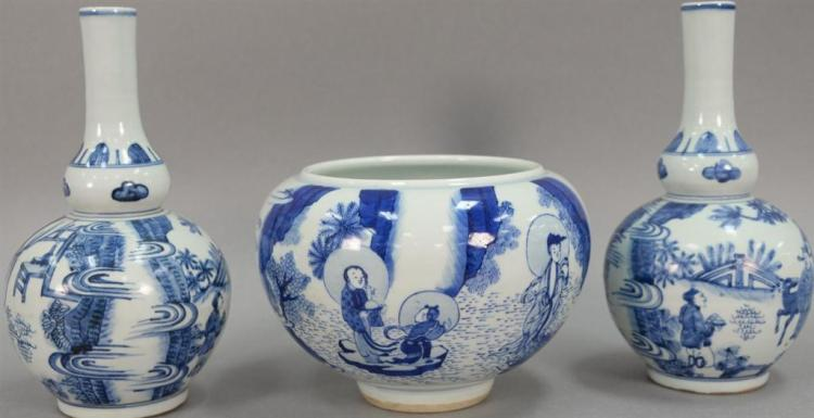 Three blue and white Oriental porcelain pieces to include a pair of double gourd globular vases and a blue and white pot. hts. 6 1/2...