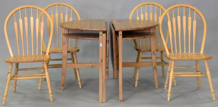 Six piece lot including two part table and four oak chairs. dia. 39 1/4in.