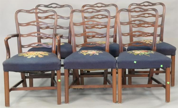 Seven piece mahogany dining set with triple pedestal dining table and six ribbon back Chippendale style chairs with needlepoint seat...