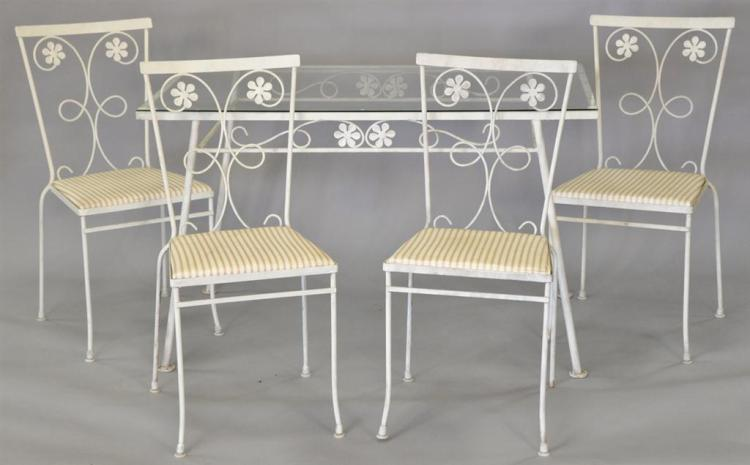 Wrought iron glass top table and four chairs. top: 48 1/4