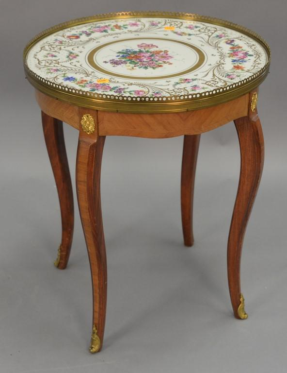 Small stand with French porcelain inset top. ht. 21in., dia. 18in.