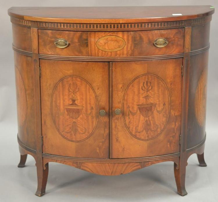 Mahogany half round cabinet with fitted drawer interior. ht. 34in., wd. 40in.; dp. 20in.