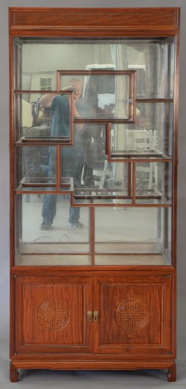 Chinese curio cabinet with eight glass shelves. ht. 79 3/4in., wd. 36in.