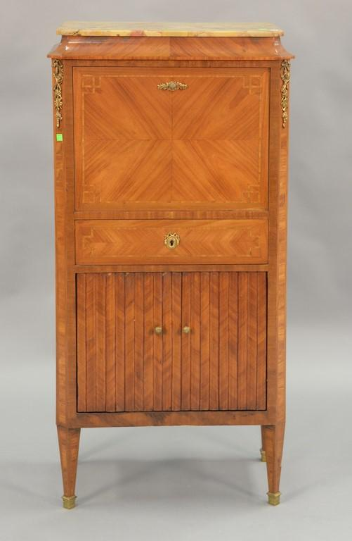 Louis XVI style marble top cabinet with two drop down doors, each with magazine racks and one drawer. ht. 50in., wd. 25in., dp. 14in.