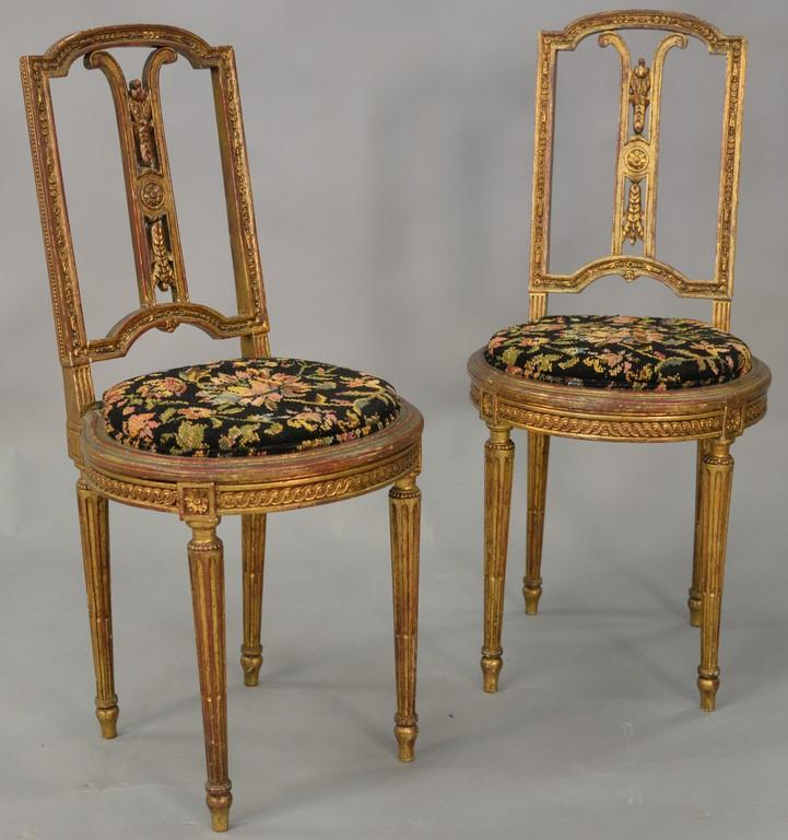 Pair of Louis XVI gilt side chair.