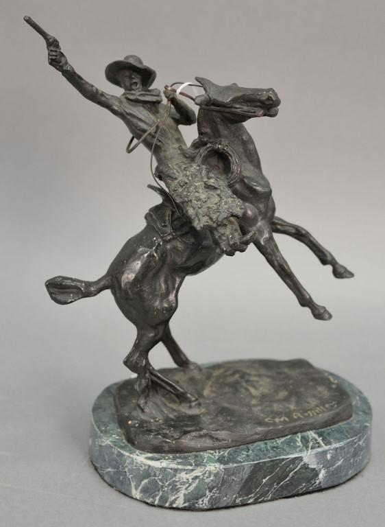 C.M. Russell bronze sculpture of a cowboy on a granite base. ht.11 1/2in.