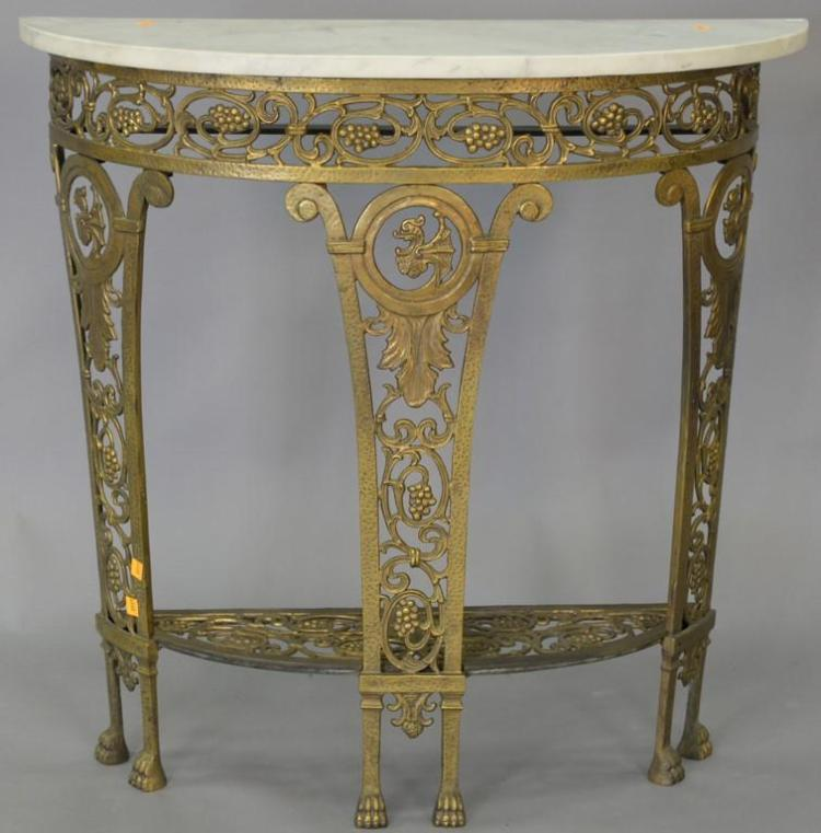 Iron marble top demilune table. ht. 32in., wd. 32 1/2in., dp. 12in.