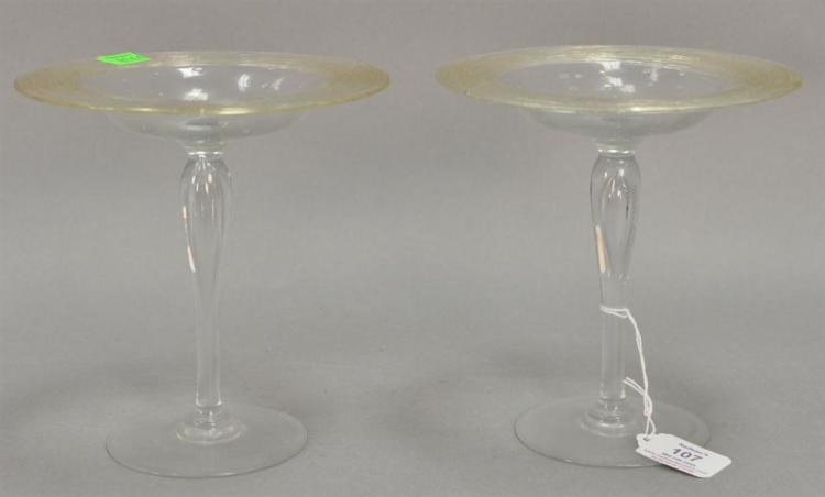 Pair of Steuben crystal threaded compotes, colorless with amber threading and bubbles in dish. ht. 7in.