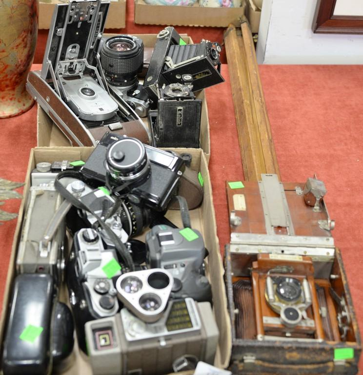 Group of vintage cameras and equipment to include Polaroid model 95B, Agfa, Kodex, Pentax cameras, Minolta 75, and Korona wood camer...