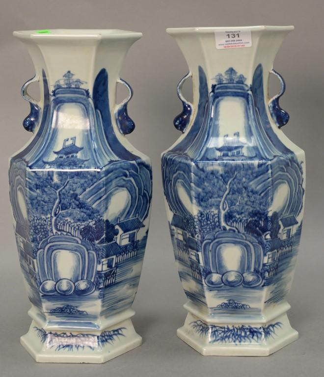 Pair of blue and white porcelain vases with landscape scenes. ht. 14in.