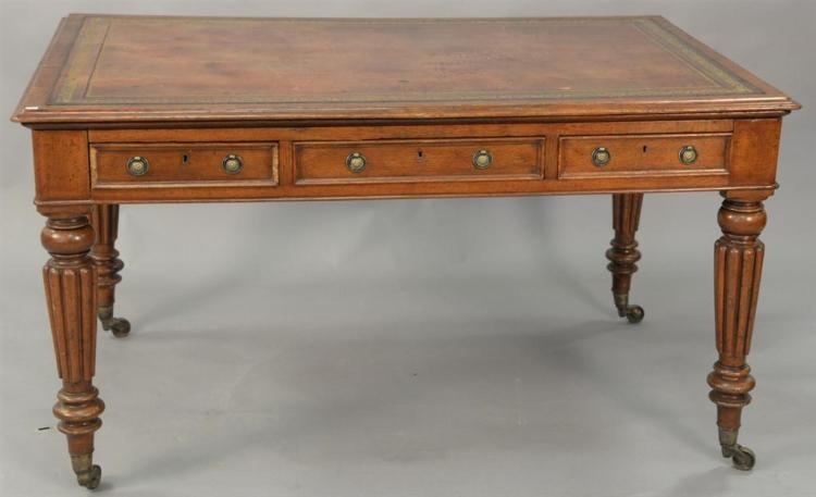 George IV oak writing table with tooled leather top and three drawers on either side, 19th century. ht. 30in., top: 36