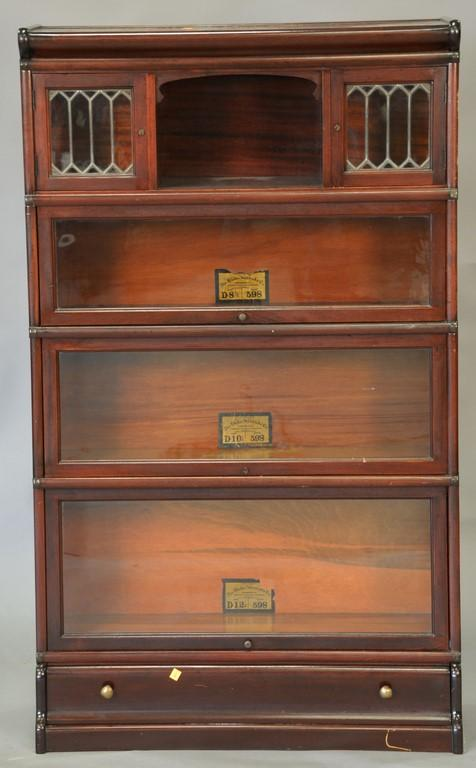 Globe Wernicke mahogany stacking bookcase with two leaded doors plus drawer in base. ht. 58in., wd. 34in., dp. 11in.
