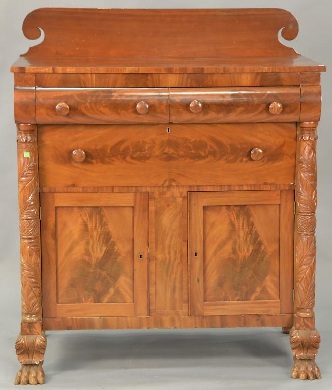 Federal mahogany and cherry server with carved columns and paw feet, circa 1840. ht. 48in., wd. 46in., dp. 21in.