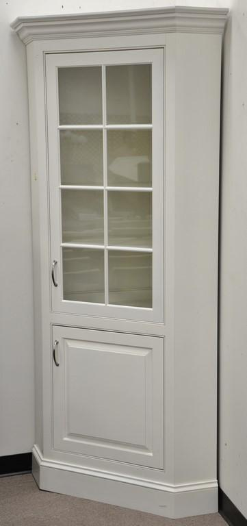 Pair of custom contemporary corner china cabinets. ht. 84in., wd. 38in.